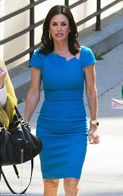 courteney cox highlights hour glass figure in blue bodycon dress