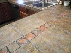 i like tiled countertops especially like the use of thes larger