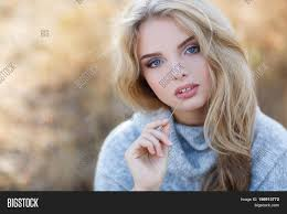 autumn portrait of beautiful young woman with long blonde hair and
