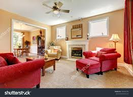 living room living room round beige table on red carpet