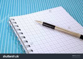 Writing On Graph Paper Pen Graph Paper Notebook On Blue Stock Photo 62008024 Shutterstock