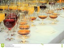 wine glasses with alcoholic drinks on the table stock photo