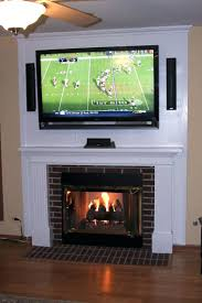 flat screen fireplace mantel white mounting hiding wires hanging