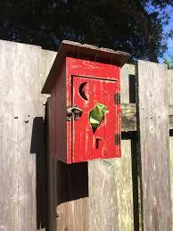 a birdhouse turned into a dog bag dispenser for my backyard