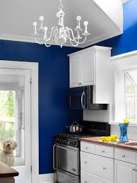 blue wall room plus white wooden cabinet and brown top also silver