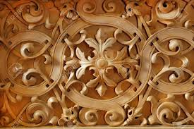 wood carved ornament on the wall of christian church stock photo