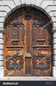 beautiful historical wooden carved door ornaments stock photo