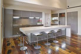 kitchen with island design blue design accent color on cabinets built in wine rack