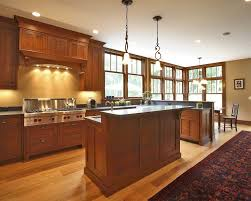 Pendant Lighting For Island Kitchens with Stepped Island Kitchen Craftsman With Shaker Cabinets Rubbed