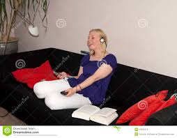 chilling teen on couch stock photo image of multitasking 24340476