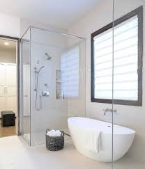 minimalist bathroom designed with white freestanding tub and