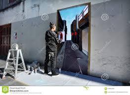 graffiti artist paint a mural on a wall editorial stock image artist artwork auckland graffiti mural paint wall