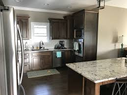 what color countertops with walnut cabinets walnut stained cabinets alaska white granite white