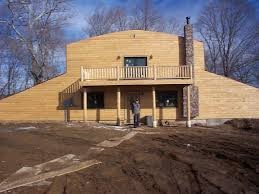 concrete earth sheltered home being built in banner news