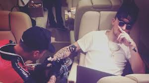 johnny manziel finds time to get a huge tattoo while riding a