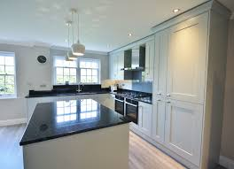 grey kitchen cupboards with black worktop partridge grey units with black granite worktops up stands