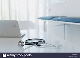 Office Desk Close Up Stethoscope And Laptop On White Desk In Doctors Office Stock Photo