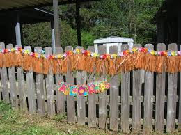 fascinating orange fringed from raffia material on nice fence