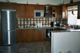 Design A New Kitchen by Good Looking Grey Kitchen Countertops With Cream Cabinet 8906