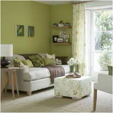 green livingroom living room with green paint colors maybe a wall in the