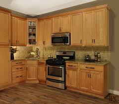 gorgeous golden oak kitchen cabinets with round stainless steel