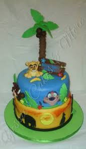 the lion king baby shower cake bottom tier is yellow cake filled