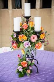 knoxville florists a low centerpiece of fresh flowers with a pillar candle in