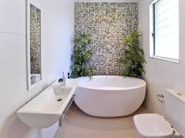 modern freestanding bathtubs with mosaic wall decor