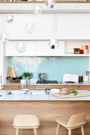 herringbone kitchen backsplash 9 inspirational kitchens with geometric tiles shiny light blue