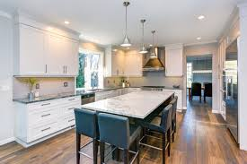 how to make a kitchen island with stock cabinets the kitchen island vs the kitchen table