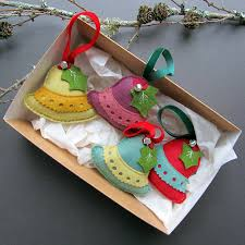 four handmade bell christmas decorations in a gift box by