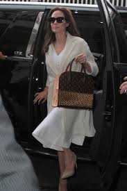 angeline jolie with christian louboutin and louis vuitton