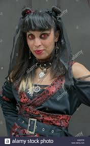 a wearing red costume contacts at witchsfest usa in greenwich