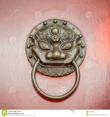 foo dog or lion door knocker on beijing red door stock photo