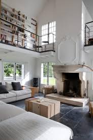 Living Room Library by Tall Living Room With A Library Balcony In A Restored Home Outside