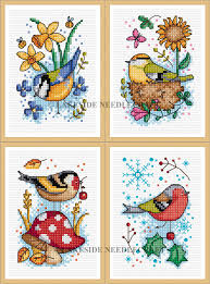 seasonal birds set of 4 cross stitch kits
