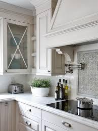 glazed white kitchen cabinets u0026 carrera marble tops