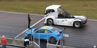 volvo race car truck versus race car track battle outcome is impossible to