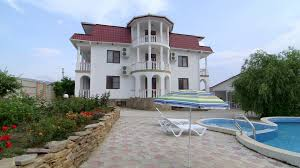 three story house three story house with white balustrade balcony swimming pool and
