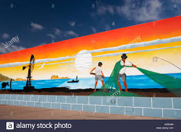 mural depicting fishing scene painted on wall in village on mural depicting fishing scene painted on wall in village on lanzarote in the canary islands
