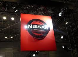 nissan logo file osaka motor show 2013 1 nissan logo jpg wikimedia commons