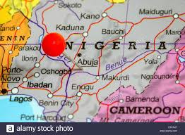 Push Pin Map Close Up Of A Red Pushpin On A Map Of Nigeria Stock Photo Royalty