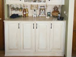 Washer And Dryer Cabinet Washer Dryer Hidden Behind Bifold Cabinet Doors Laundry Room