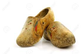pair of very old traditional dutch decorated wooden shoes on