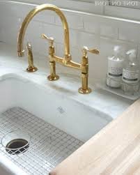 brass single hole unlacquered kitchen faucet two handle pull down