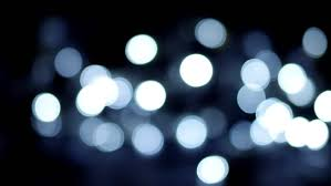 bright twinkling lights against a black background stock footage