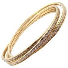 gold bangle bracelet with diamonds images Cartier trinity diamond gold bangle bracelet at 1stdibs jpg