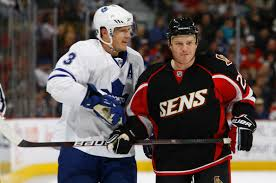 chris neil and dion phaneuf photos photos toronto maple leafs v