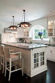 l shaped kitchen island with foot rail transitional kitchen