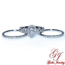 92918 pear shape halo bridal set center two